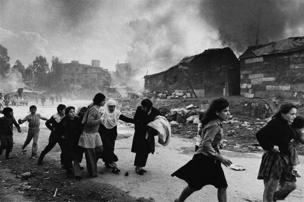 Palestinians flee attack. Up to 1,500 Palestinians died in the Karantina massacre by Christian Falangist gunmen. Beirut, Lebanon 1976. Don McCullin